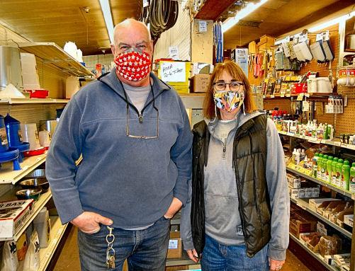 Brother and sister Tony Cassinellli and Pegg Cassinelli-Beeson had to replace many antique wooden shelves (such as at right) with pegboard and metal shelving (seen at left) after a pickup smashed through the wall into Wichita Feed & Hardware last November.