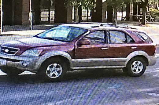 This still image from a video surveillance recording shows a Subaru Forester getting up �ramming speed� on S.E. Woodstock Boulevard, before smashing into the entrance of the Woodstock U.S. Bank branch. The driver is now wanted for felony hit and run.