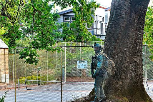 Portland SERT officer shields himself from a reportedly-armed intruder in a newly-built but vacant condominium near Sellwood Park