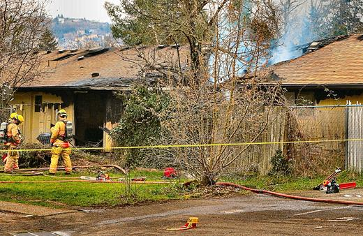 Standing by at the back of Brentwood-Darlington four-plex, firefighters kept watch for fire flare-ups � near where the deadly blaze killed one resident.