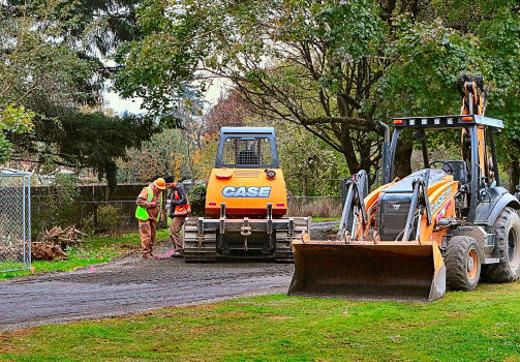 Working in Flavel Park, construction crewmembers checked their work against the plans, as they got ready to pave the multi-use path � part of the �Springwater Connector Neighborhood Greenway� project still underway in Brentwood-Darlington.